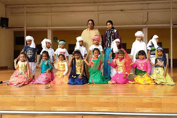 Kids performance on stage during morning prayer